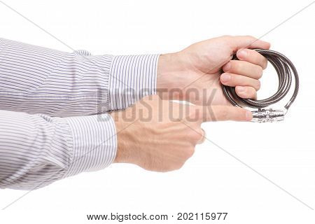 Man's hands the combination lock for a bicycle on a white background isolation