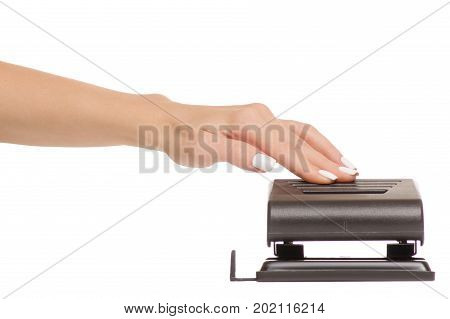 Female hands clerical punch on white background isolation