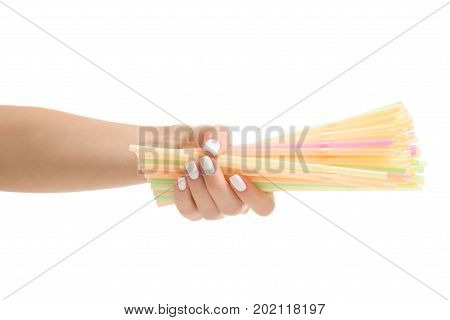 Female hands with straws multicolored on white background isolation