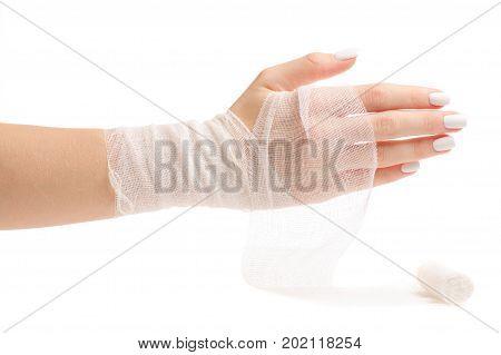 Female hand in bandage on white background isolation