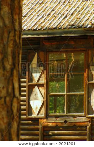 Window with the opened shutters in a wooden frame which the forest is visible through poster