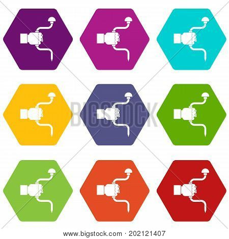 Vintage hand drill in man hand icon set many color hexahedron isolated on white vector illustration