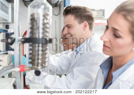 Scientists in research laboratory analyzing samples