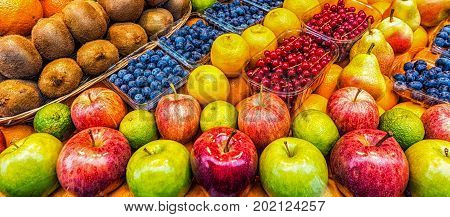 Apples and fruits at a market vendor stand
