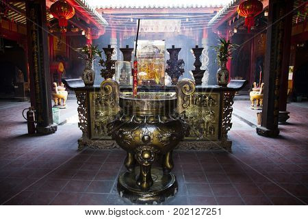 Ho Chi Minh City, Vietnam - March 26, 2017: Burning incense sticks in Ong Bon Pagoda, dedicated to Ong Bon, the guardian who presides over happiness and wealth, in Cholon, the Chinatown area of Saigon