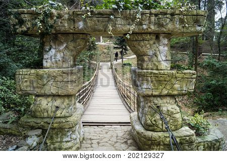 Suspension bridge in the arboretum of the city of Sochi, March 2017..