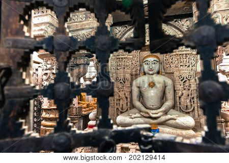 Wide angle picture of Jain God statue inside the Jain Temples located in the Golden City of Jaisalmer in India.