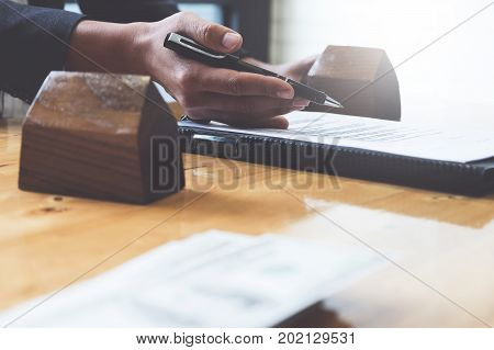 Businessman Hand And Contract Agreement Paper With Customer To Sign Contract. Real Estate And Agreem