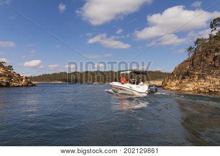 Furnas Dam in Minas Gerais Brazil Jul 11th 2017. Tourists in motorboat in Capitolio MG Brazil
