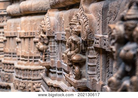 Horizontal picture of amazing marble stone carving of Jain Gods in Jain Temples inside the fort of Jaisalmer in India.