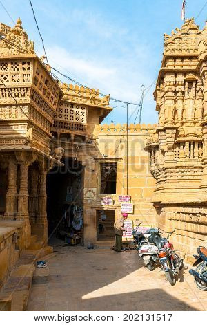 JAISALMER RAJASTHAN INDIA - MARCH 09 2016: Vertical picture of Jain Temples entrace carved yellow sandstone architecture in Jaisalmer known as Golden City in India.