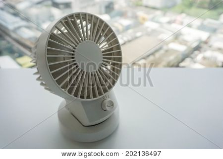 close up white portable USB desktop fan plug in with computer office