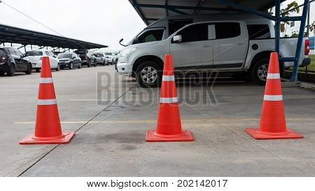 Plastic signaling traffic cone encloses a place in the parking lot for trucksOrange cones used to close off a streettraffic cone