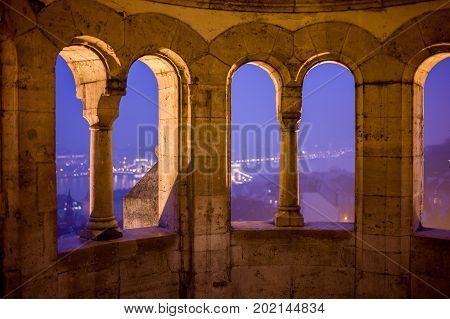 Budapest view from an old summerhouse down to the Danube river in winter evening