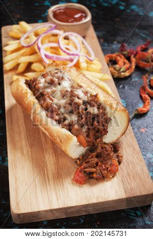 Sloppy joes ground beef sandwich with ketchup and french fries