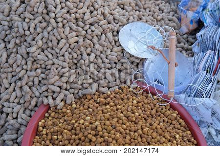 Dhaka, bangladesh, august 2017-collection nut fruit items displayed on floor for sales located at aftab nagar cow market in dhaka in bangladesh taken on 30, august 2017.