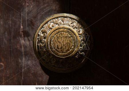 Traditional Bronze Door Handle On A Wooden Door