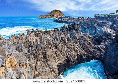 Paradise Island in the Atlantic Ocean. Fantastically beautiful coast. Rocks, coves and grottoes off the Atlantic coast. The concept of exotic and ecological tourism