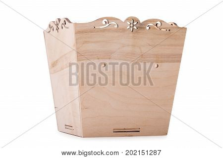A large light brown box for small things, toys or colorful blocks, isolated on a white background. A big, opened wooden chest for playthings and dolls. Copy space.