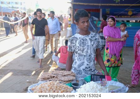 Dhaka, bangladesh, august 2017-a man selling nuts and other food item for upcomming eid ul adha which is a biggest muslim festival located at aftab nagar cow market in dhaka in bangladesh taken on 30, august 2017.