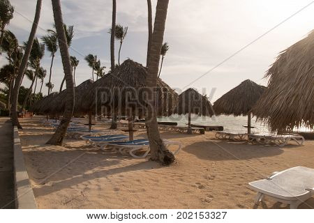 Water Bungalows In Lagoon At Sunset Holidays Concept