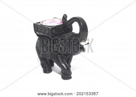 Candle holder elephant figure shape made from wood , popular souvenir for tourist from Thailand isolated on white background