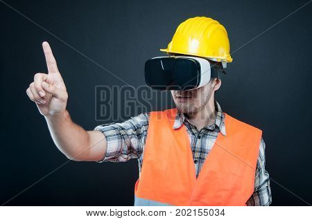 Constructor Wearing Vr Goggles Gesturing With Index Finger