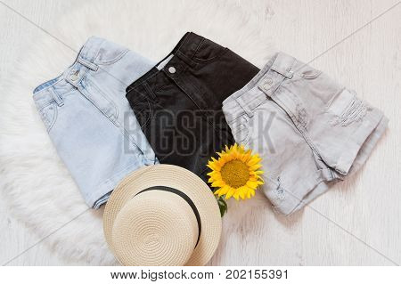 Three Denim Shorts, Straw Hat, Shorts. On White Fur, Top View