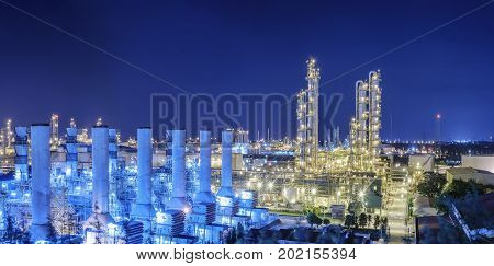 Petrochemical plant and lighting at night Oil and gas refinery industry with night sky background