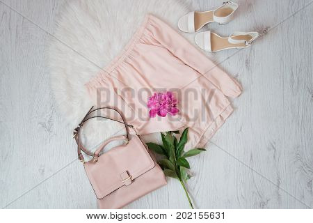 Pink Blouse, Bag, Shoes And A Bouquet Of Peonies. Fashionable Concept, White Fur On The Background