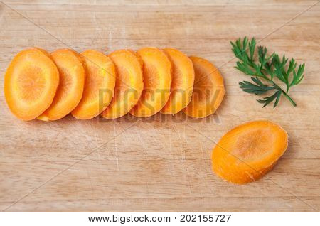 Raw Carrot Sliced On A Wooden Board