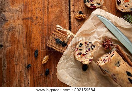 Christmas Cake Cookies Batter on wooden board. Fruit cake cookies dough. Cookies in process. Top view.