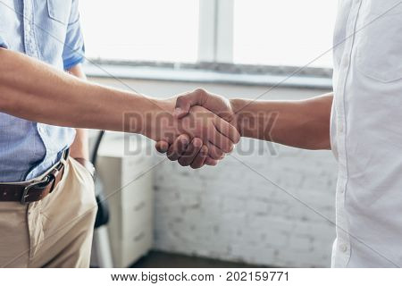 close-up partial view of business people shaking hands