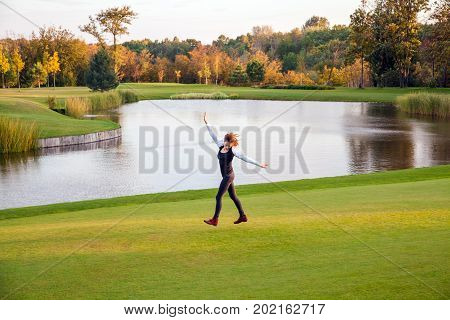 Autumn, Lake, Golf Course. Young Adult Woman Running