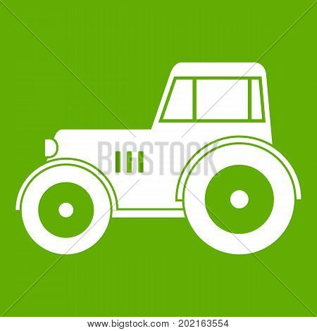 Tractor icon white isolated on green background. Vector illustration
