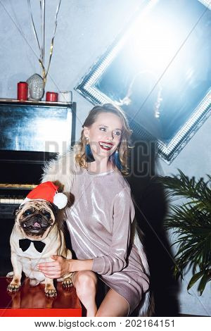 Woman With Pug In Santa Hat