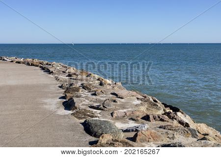 Horizon view over Atlantic Ocean and stone pier pathway from Jard sur Mer in Vendee France