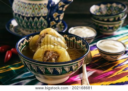 Stuffed peppers with broth, oriental uzbek style cuisine.