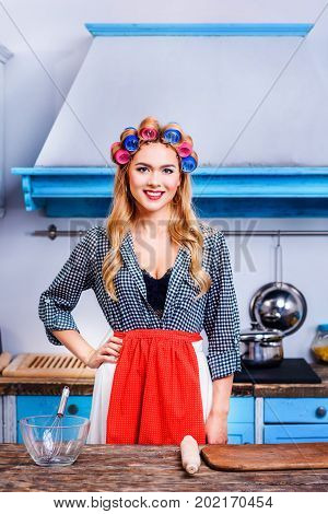 Housewife In Apron And Curlers