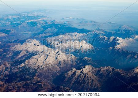 Aerial view down on rocky peaks of Maja Jezercë highest mountain of Albanian Alps Prokletije and Dinaric Alps 2694 m high Malësi e Madhe District Shkodër County Albania