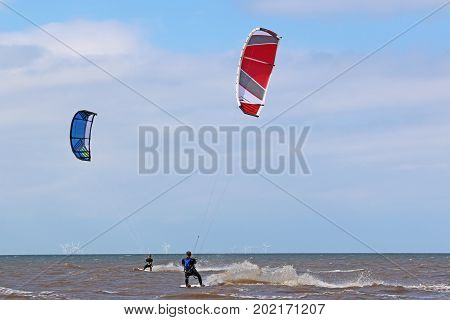 kitesurfer riding his board on the sea