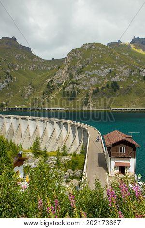 Fedaia Lake In Dolomites Alps, Italy