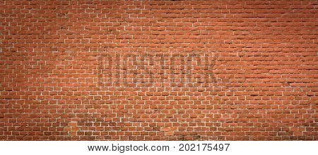 Red brick wall background. Very old natural brickwork texture