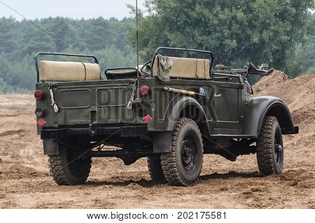 MILITARY OFF-ROAD VEHICLE - Car on a dirt road