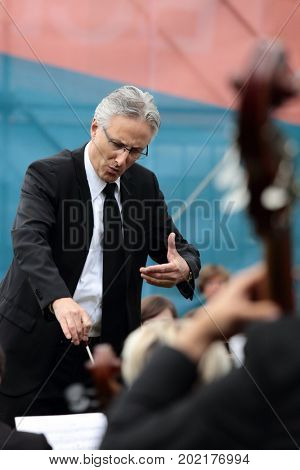 ST. PETERSBURG, RUSSIA - JULY 19, 2017: Conductor Oliver Weder and International symphony orchestra Tavrichesky performing The Marksman of C. M. von Weber during the festival All Together Opera