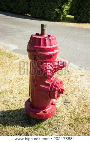 Red fire hydrant on the street, Canada
