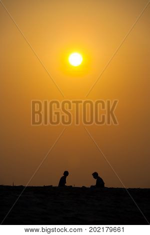 Two People Silhouette Beach Orange Sunset Sun Sky