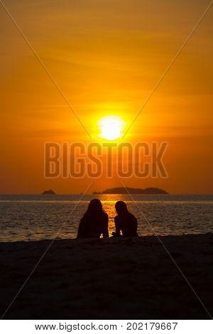 Two People Silhouette Watching Sunset Beach Ocean