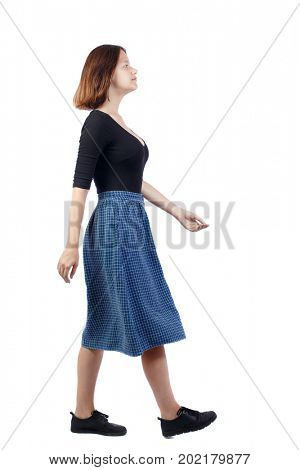 side view of walking  woman. beautiful girl in motion.  backside view of person.  Rear view people collection. Isolated over white background. The girl in the blue checkered passes by. side view.