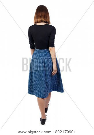 back view of walking woman in dress. beautiful girl in motion. backside view person.  Rear view people collection. Isolated over white background. girl in the blue developing skirt goes into distance